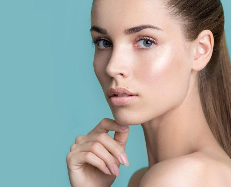 Woman looking back showing glowing skin
