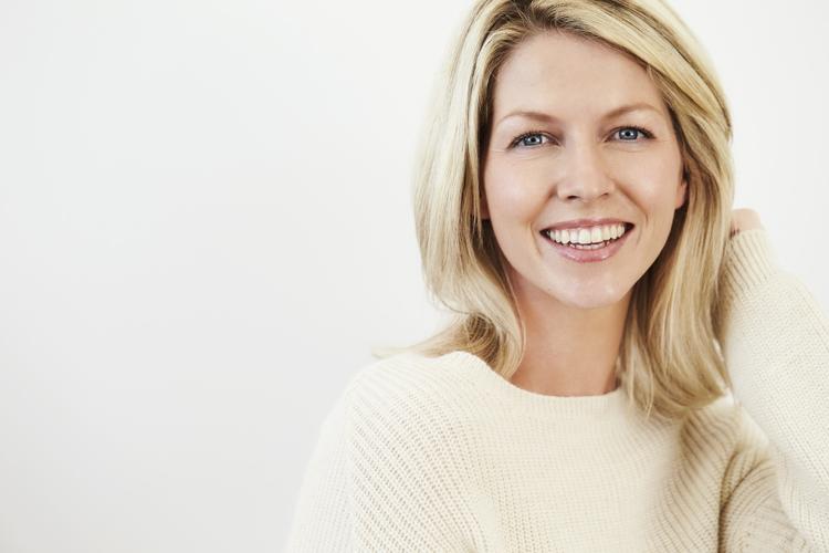 woman smiling showing facial & neck contours