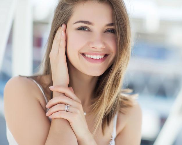 woman smiling showing glowing skin